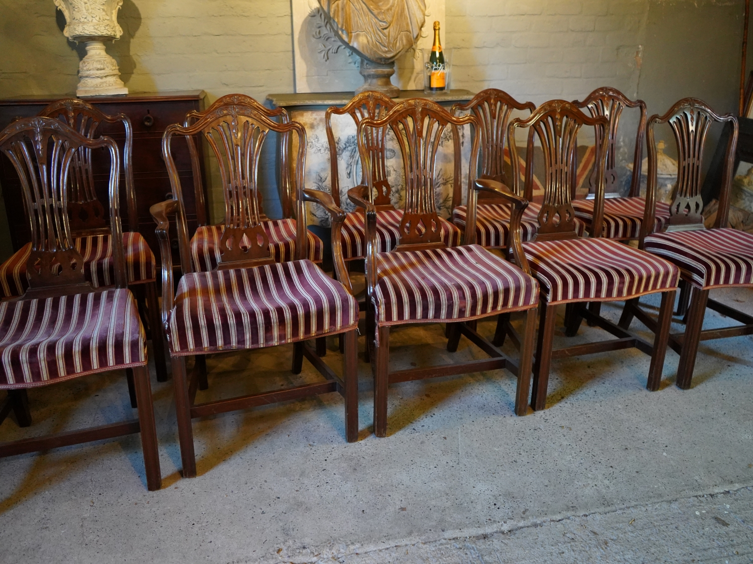 A Fine set of 10 Mahogany Dining Chairs comprising 8 single and 2 matching armchairs. Georgian in style to a design by George Hepplewhite.